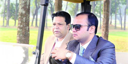 Additional Managing Director of Bashundhara Group Safwan Sobhan drives a golf cart during his visit to the Bashundhara Bangladesh Open venue