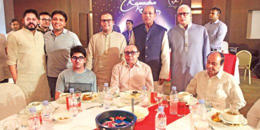 Chairman of Bashundhara Group Ahmed Akbar Sobhan (sitting middle), Vice-Chairmen of Bashundhara Group Shafiat Sobhan Sanvir (standing third left), Safwan Sobhan Tasvir (standing fourth left) and senior officials are seen at an iftar party hosted by Sheikh Jamal Dhanmondi Club Ltd at Radisson Blu Water Garden in the capital on Friday. -Kamrul Islam Ratan